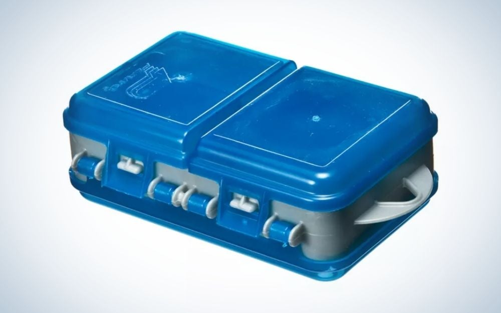 A closed box of strong blue color in the shape of a rectangle as well as in the shape of a suitcase.
