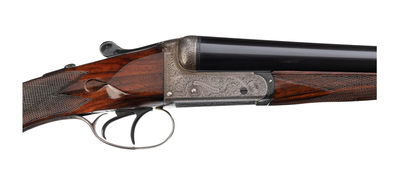 Engraved double-barrel shotgun.