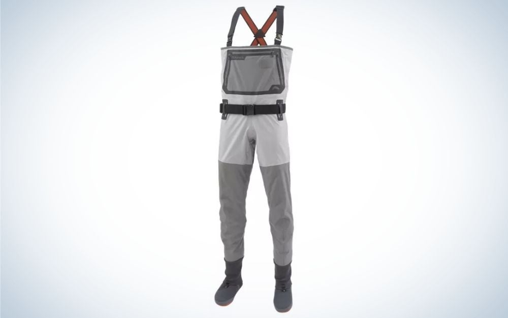 A pair of overalls which have two laces from above and legs with long sleeves below as well as a black belt in the middle, as well as are gray in color and with a square pocket on the front.
