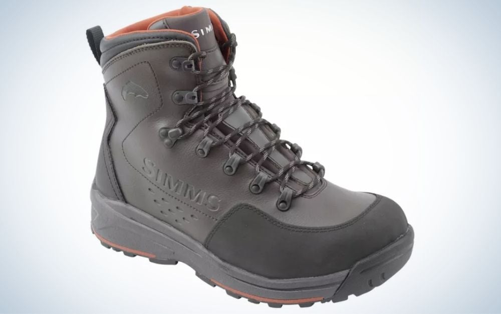 A pair of dark gray winter shoes with a thick black rubber and some strong gray laces.