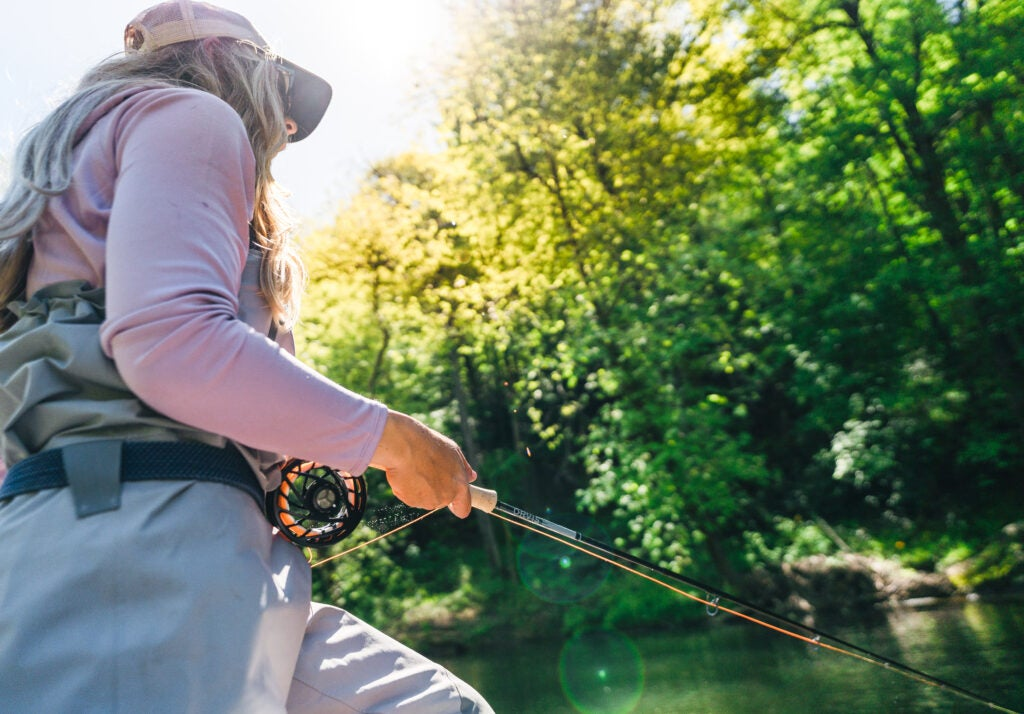 Fly angler fishes with the new Orvis Helios Blackout rod