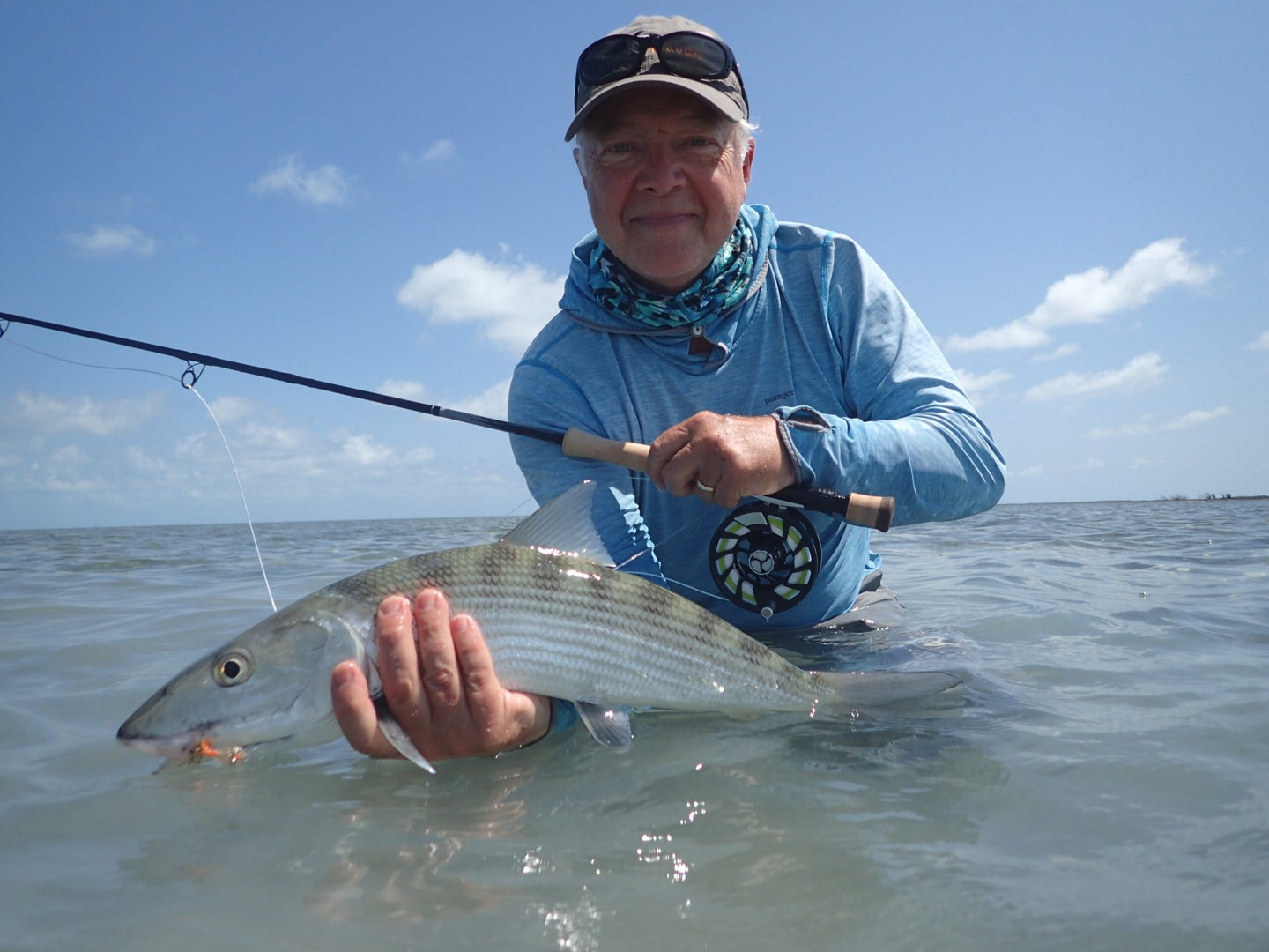Saltwater fly fisherman catches a bonefish with the Orvis Helios blackout rod