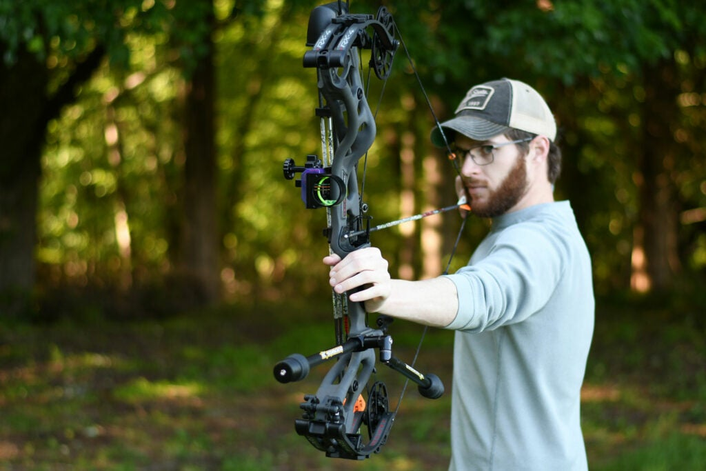 Archer shows how to draw a compound bow