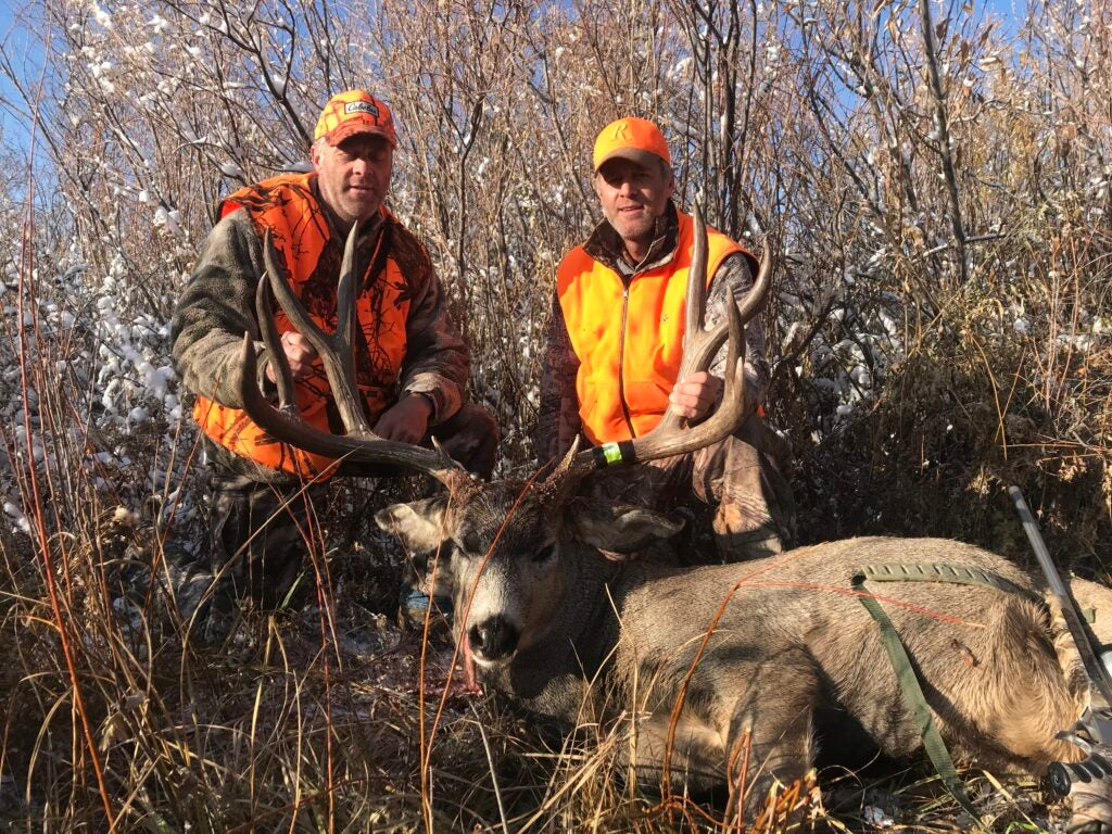 Smith twins and mule deer