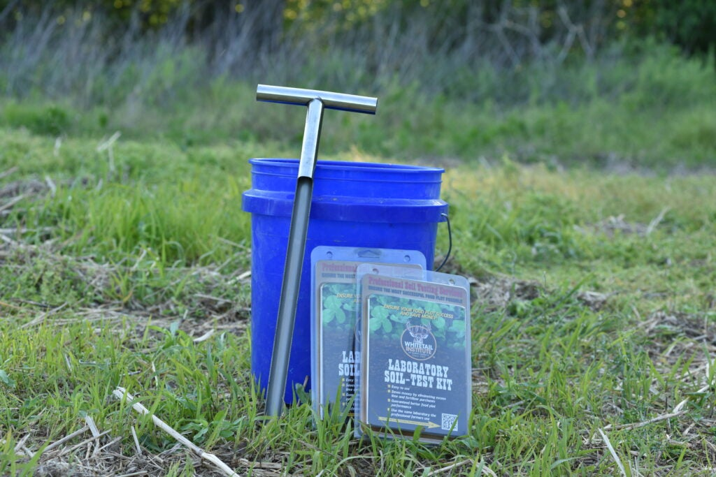 Soil test kit with soil probe and a bucket.