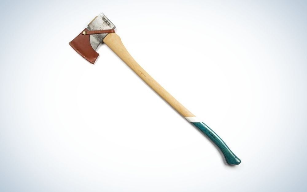 A axe with a long wooden tail and half of its green color, as well as its top touches the steel and covered in half with brown leather cover.
