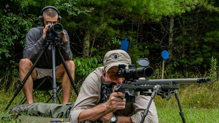 Long range shooter working with a spotter