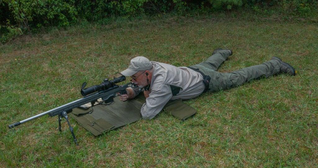 long range rifle with shooting mat