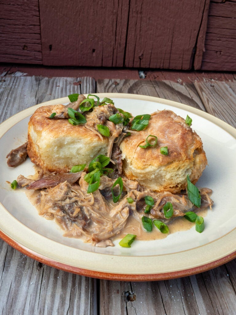 Braised meat with biscuits and gravy.