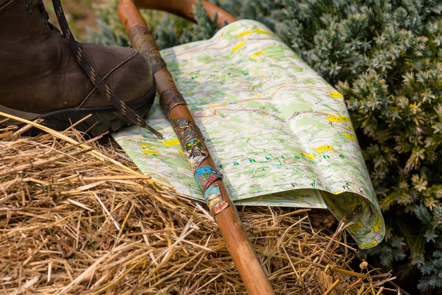 walking stick on the ground with a map.
