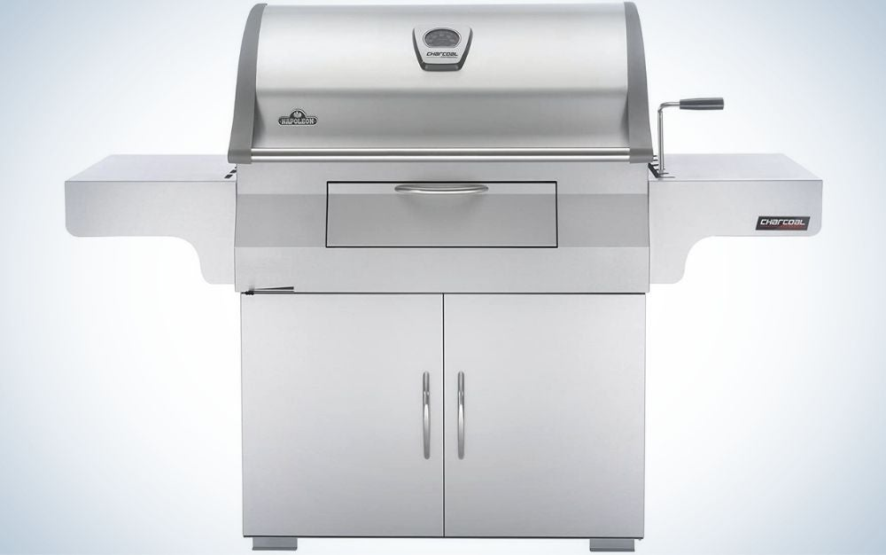 A large portable grill with four sturdy holders and all gray color with two spaces on the side.