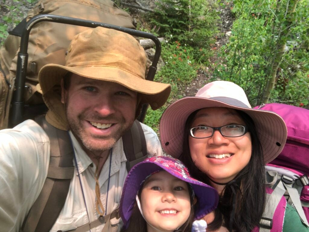 family hiking taking a selfie.