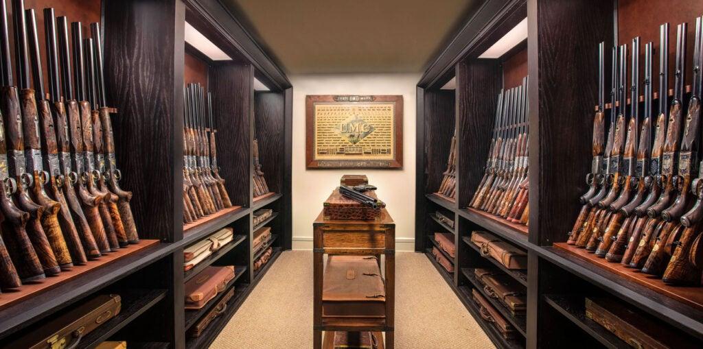 room full of classic shotguns and dangerous game guns.