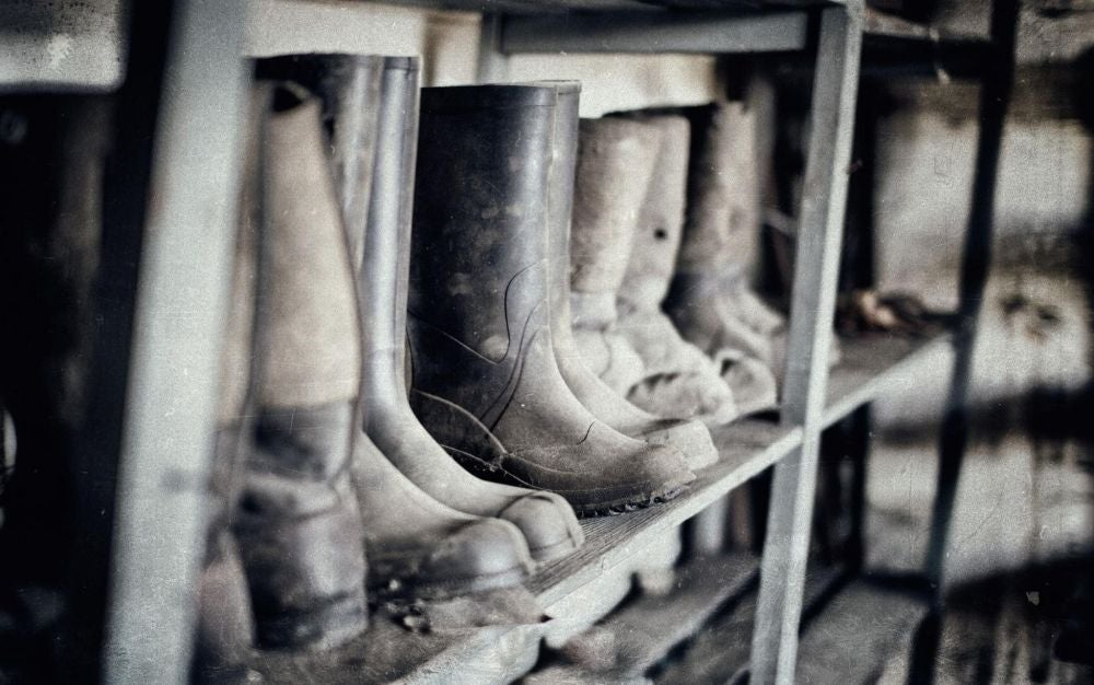 Rubber hunting boots on the shelf