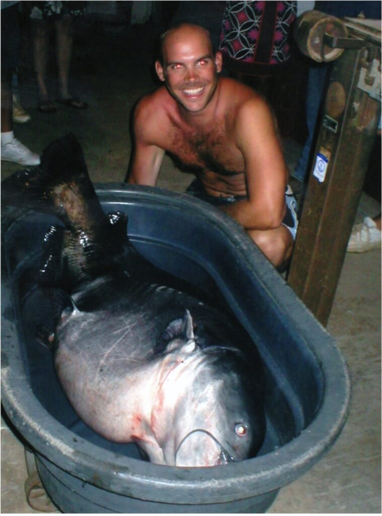 Richard Nicholas Anderson with the all-tackle world record blue catfish