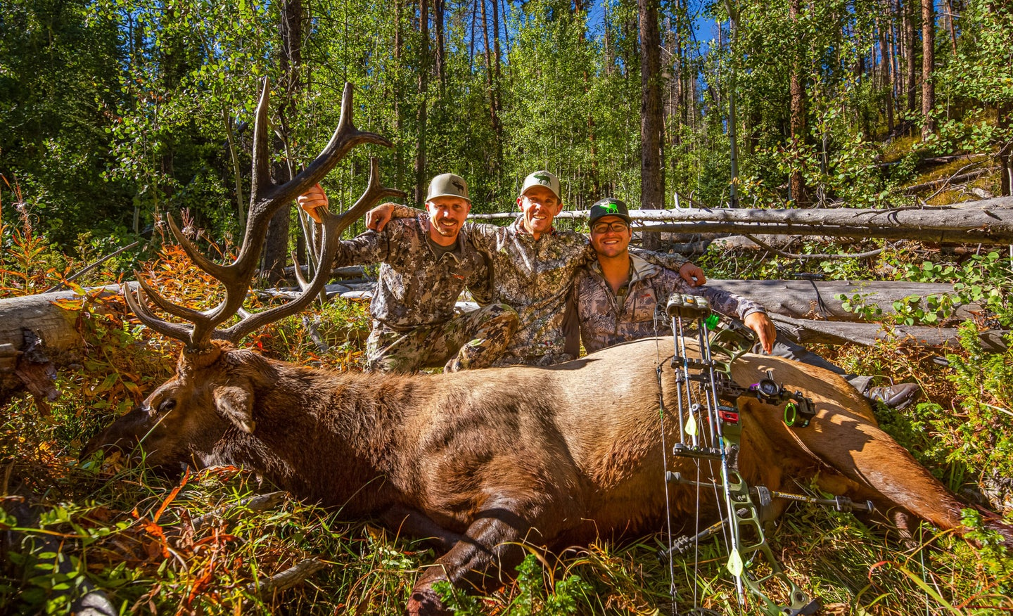 Jace Bauserman and friends with bull elk