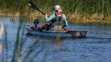 angler fishing off kayak with fish finder