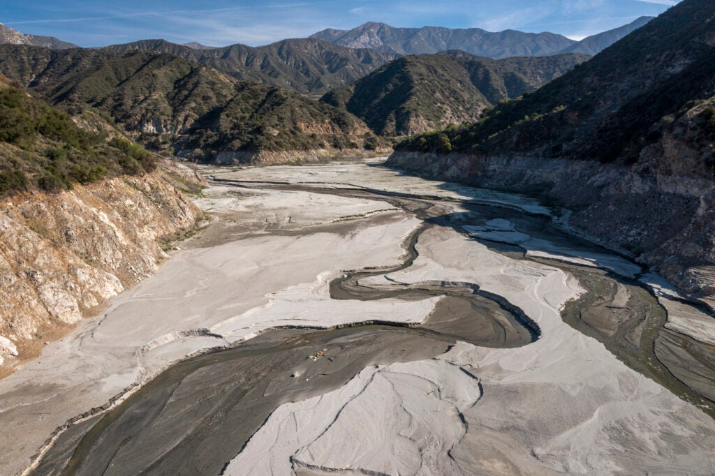 An almost completely dry reservoir bottom in California's hills
