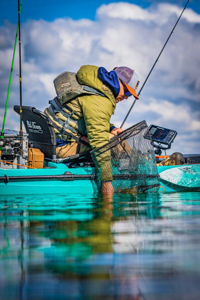 Fisherman using fish finder