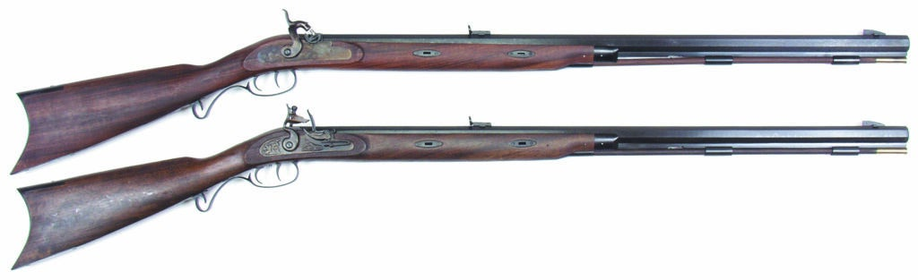Two traditional muzzeloader rifles on a white background.