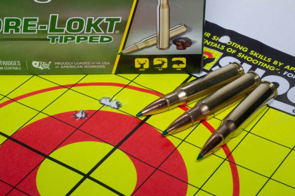 Bullets next to a group on a target.