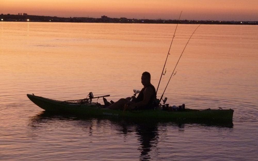 A man in a fishing kayak.