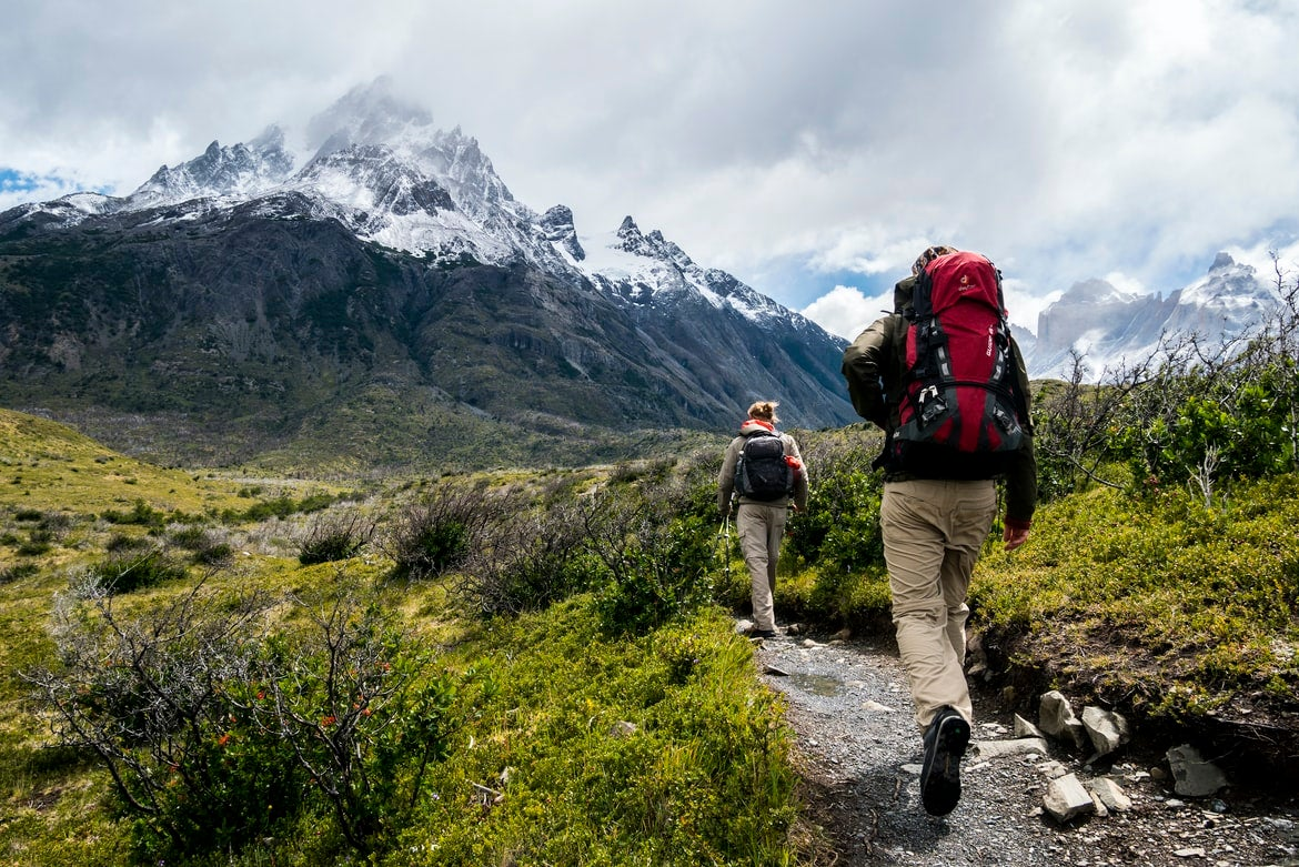 Hikers approach a mountain