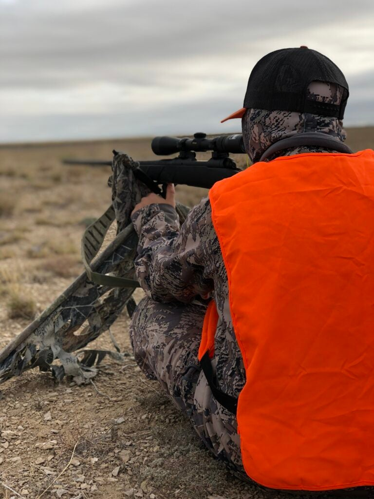 Jace Bauserman aims at a pronghorn antelope